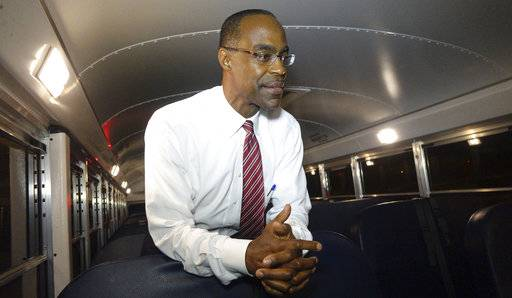 "This Aug. 24, 2015 photo shows Broward School Board Superintendent Robert Runcie inside a bus in Pembroke Pines, Fla. The Florida Legislature recently changed state law to allow any resident to challenge their school district's textbooks and curricula and get a hearing before an outside mediator. Runcie, who is also the president of the state superintendents association, said the changes are ""cumbersome."" Districts have always encouraged parents and residents to voice concerns about materials and curricula, he said, and the mediator is an unnecessary step. (Joe Cavatetta/South Florida Sun-Sentinel via AP)"