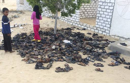 Discarded shoes of victims remain outside Al-Rawda Mosque in Bir al-Abd northern Sinai, Egypt. a day after attackers killed hundreds of worshippers, on Saturday, Nov. 25, 2017. Friday's assault was Egypt's deadliest attack by Islamic extremists in the country's modern history, a grim milestone in a long-running fight against an insurgency led by a local affiliate of the Islamic State group.(AP Photo)