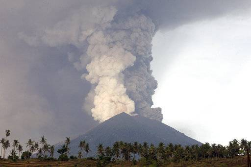 A view of the Mount Agung volcano erupting in Karangasem, Bali, Indonesia, Monday, Nov. 27, 2017. The volcano on the Indonesian tourist island of Bali erupted for the second time in a week on Saturday, disrupting international flights even as authorities said the island remains safe. (AP Photo/Firdia Lisnawati