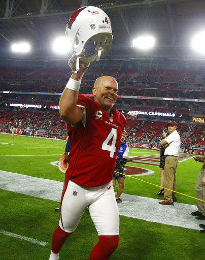 Arizona Cardinals kicker Phil Dawson (4) leaves the field after an NFL football game against the Jacksonville Jaguars, Sunday, Nov. 26, 2017, in Glendale, Ariz. The Cardinals won 27-24. (AP Photo/Ross D. Franklin)