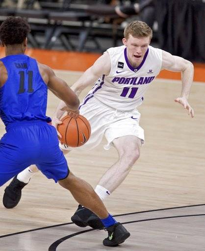 Portland guard Josh McSwiggan, right, dribbles past DePaul guard Eli Cain during the first half of an NCAA college basketball game in the Phil Knight Invitational tournament in Portland, Ore., Sunday, Nov. 26, 2017. (AP Photo/Craig Mitchelldyer)
