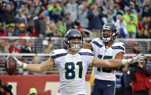 Seattle Seahawks tight end Nick Vannett (81) celebrate his touchdown reception with teammate Tyler Lockett during the second half of an NFL football game against the San Francisco 49ers Sunday, Nov. 26, 2017, in Santa Clara, Calif. (AP Photo/Don Feria)