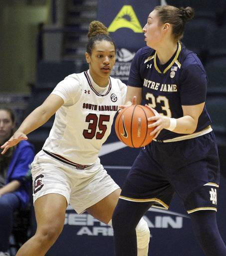 South Carolina's Alexis Jennings (35) covers Notre Dame's Jessica Shepard (23) during the half of an NCAA college basketball game at the Gulf Coast Showcase basketball tournament championship finals Sunday, Nov. 26, 2017, in Estero, Fla. (AP Photo/Luis M. Alvarez)