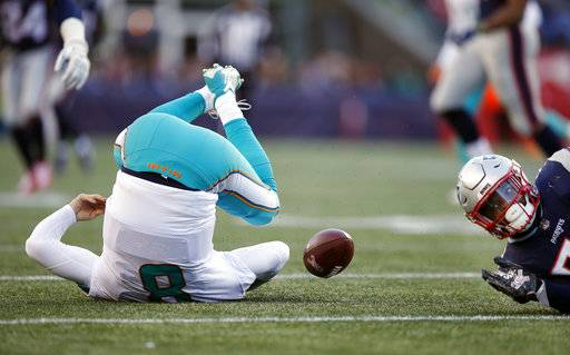 New England Patriots linebacker Elandon Roberts (52) sacks Miami Dolphins quarterback Matt Moore during the second half of an NFL football game, Sunday, Nov. 26, 2017, in Foxborough, Mass. (AP Photo/Michael Dwyer)