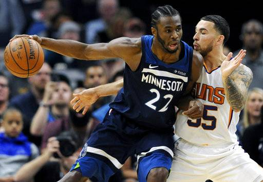 Phoenix Suns' Mike James (55) guards against Minnesota Timberwolves' Andrew Wiggins (22) during the second quarter of an NBA basketball game on Sunday, Nov. 26, 2017, in Minneapolis. (AP Photo/Hannah Foslien)