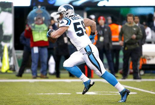 Carolina Panthers middle linebacker Luke Kuechly (59) returns a fumble for a touchdown during the second half of an NFL football game against the New York Jets, Sunday, Nov. 26, 2017, in East Rutherford, N.J. (AP Photo/Kathy Willens)