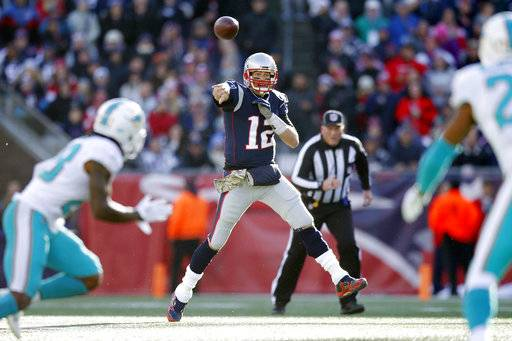 New England Patriots quarterback Tom Brady (12) passes against the Miami Dolphins during the first half of an NFL football game, Sunday, Nov. 26, 2017, in Foxborough, Mass. (AP Photo/Michael Dwyer)