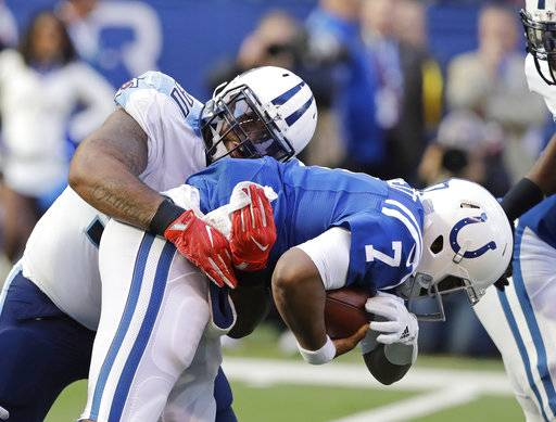 Indianapolis Colts quarterback Jacoby Brissett (7) is sacked by Tennessee Titans' DaQuan Jones (90) during the first half of an NFL football game, Sunday, Nov. 26, 2017, in Indianapolis. (AP Photo/Darron Cummings)