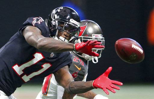 Atlanta Falcons wide receiver Julio Jones (11) makes the catch ahead of Tampa Bay Buccaneers cornerback Ryan Smith (29) during the second half of an NFL football game, Sunday, Nov. 26, 2017, in Atlanta. (AP Photo/John Bazemore)