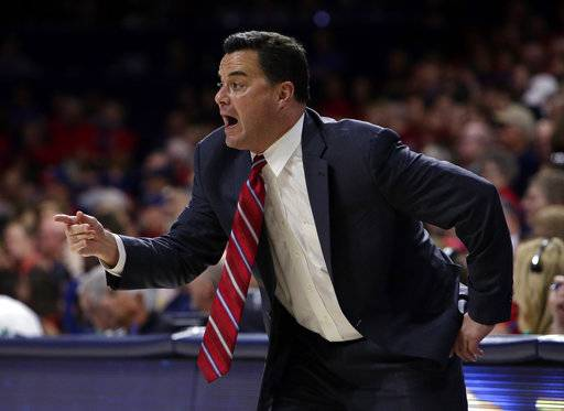 FILE - In this Nov. 10, 2017, file photo, Arizona head coach Sean Miller gestures in the first half during an NCAA college basketball game against Northern Arizona, in Tucson, Ariz. Miller's second-ranked Wildcats open play in the Battle 4 Atlantis tournament Wednesday against North Carolina State in the Bahamas. (AP Photo/Rick Scuteri, File)