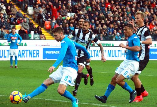 Napoli's Jorginho scores during a Serie A soccer match between Napoli and Udinese at the Friuli stadium in Udine, Italy, Sunday, Nov. 26, 2017. apoli moved back to the top of Serie A with a 1-0 win at Udinese on Sunday but it was tougher than the title hopefuls would have expected. Jorginho scored the only goal of the match after his penalty had been saved to send Napoli two points above Inter Milan, which won 3-1 at Cagliari on Saturday. (Alberto Lancia/ANSA via AP)