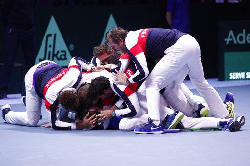 French team celebrates after France's Lucas Pouille defeated Belgium's Steve Darcis during their Davis Cup final single match at the Pierre Mauroy stadium in Lille, northern France, Sunday, Nov.26, 2017. France wins the Davis Cup. (AP Photo/Christophe Ena)