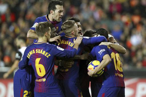 Barcelona players celebrates their first goal of the game, during the Spanish La Liga soccer match between Valencia and FC Barcelona at the Mestalla stadium in Valencia, Spain, Sunday, Nov. 26, 2017. (AP Photo/Alberto Saiz)