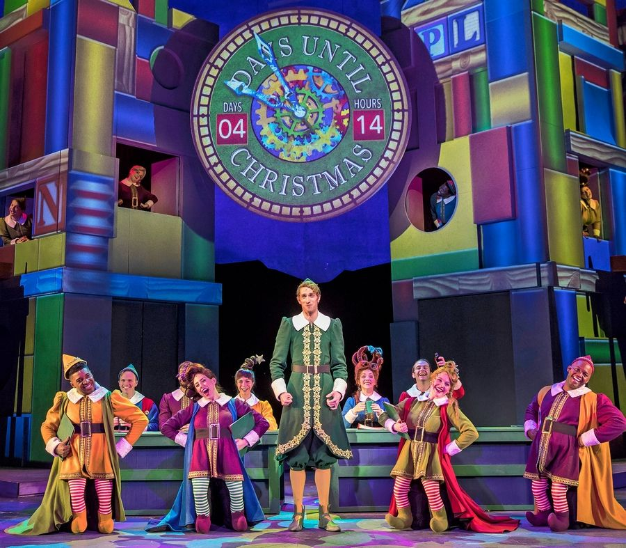 "Buddy (Kyle Adams), center, can't keep up with the toy-making quotas of the other elves in Santa's workshop in ""Elf the Musical"" at the Paramount Theatre in Aurora."