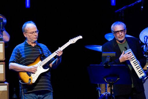 "FILE - In this July 4, 2009 file photo, Walter Becker, left, and Donald Fagen, of the U.S. group Steely Dan performs at the 43nd Montreux Jazz Festival, in Montreux, Switzerland. Fagen is suing the estate of his late band mate, Becker, over ownership of the band's name and music, a move Becker's representatives are calling ""unwarranted and frivolous.� (AP Photo/Keystone, Jean-Christophe Bott, File)"