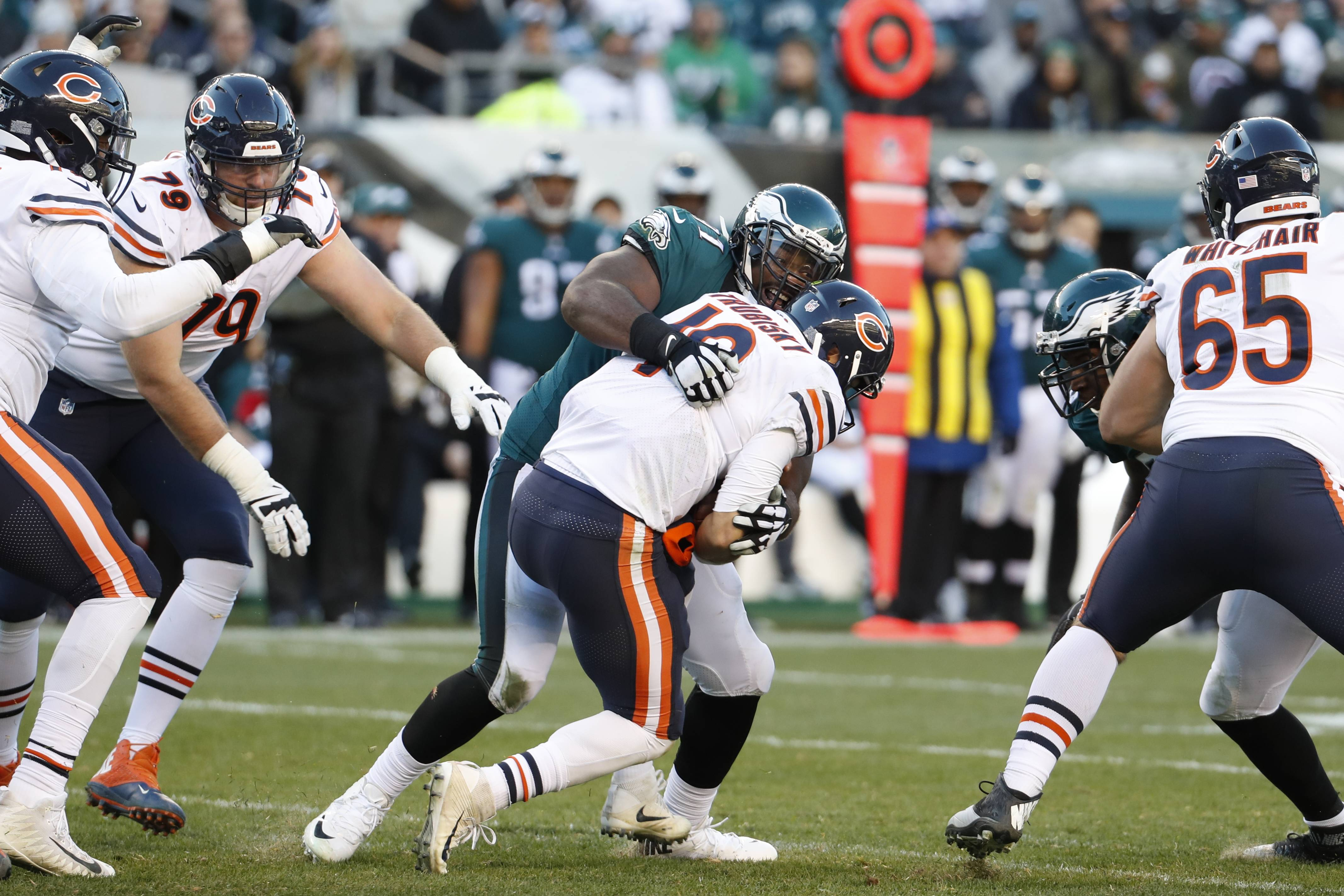Philadelphia Eagles' Fletcher Cox (91) tackled Chicago Bears' Mitchell Trubisky (10) during the second half of an NFL football game, Sunday, Nov. 26, 2017, in Philadelphia. (AP Photo/Chris Szagola)