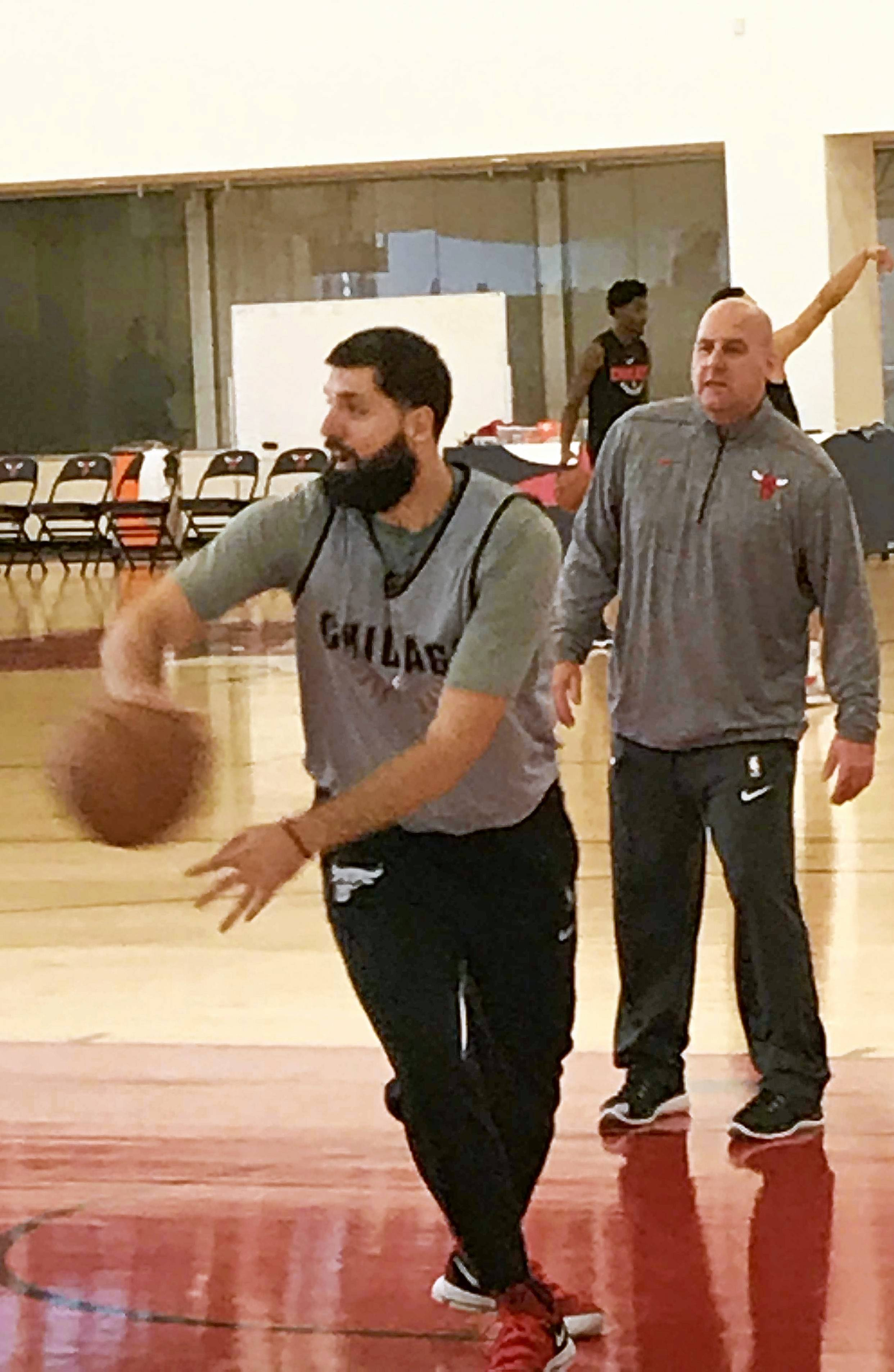 Chicago Bulls forward Niko Mirotic, under the watchful eyes of assistant coach Jim Boylen, worked out with several teammates before Monday's practice at the Advocate Center in Chicago.