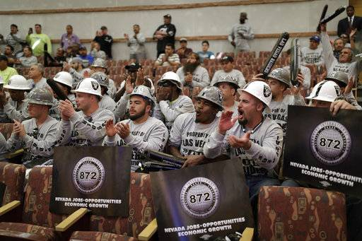 FILE - This May 18, 2017, file photo shows laborers union members cheering during a meeting of the Las Vegas Stadium Authority board, in Las Vegas. As the Supreme Court prepares to hear a challenge to the federal ban on sports betting, U.S. sports leagues are hedging their bets. The leagues are fighting the case in court, but leaders of the NBA, the NHL and Major League Baseball have said publicly that they're open to sports betting being legalized. They're preparing for a future of expanded gambling and hoping to have a say in how legalization takes effect. Only the NFL has remained steadfast in its opposition, a stance that critics see as hypocritical. (AP Photo/John Locher, File)
