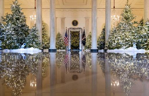 "The Grand Foyer and Cross Hall are decorated with ""The Nutcracker Suite"" theme during a media preview of the 2017 holiday decorations at the White House in Washington, Monday, Nov. 27, 2017. (AP Photo/Carolyn Kaster)"