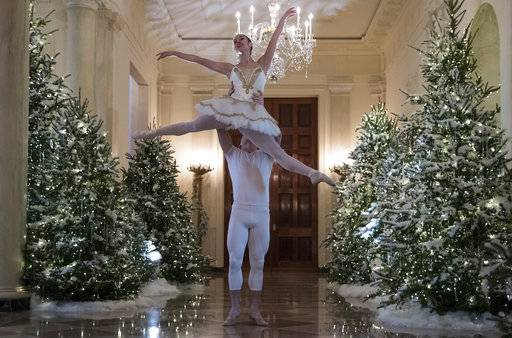 a ballerina is lifted during a performance of a piece from the nutcracker among the 2017
