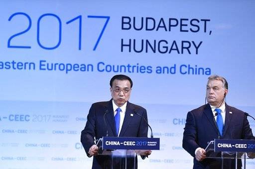 Hungarian Prime Minister Viktor Orban, right, listens to Chinese Prime Minister Li Keying while addressing a press conference during the summit of China and sixteen Central and Eastern European Countries (CEEC) in Budapest, Hungary, Monday, Nov. 27, 2017. (Szilard Koszticsak/MTI via AP)