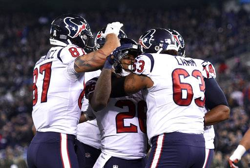 Houston Texans running back Lamar Miller, center, celebrates his touchdown with teammates in the first half of an NFL football game against the Baltimore Ravens, Monday, Nov. 27, 2017, in Baltimore. (AP Photo/Gail Burton)