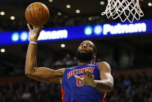 Detroit Pistons' Andre Drummond goes up to shoot during the fourth quarter of an NBA basketball game against the Boston Celtics in Boston, Monday, Nov. 27, 2017. The Pistons won 118-108. (AP Photo/Michael Dwyer)