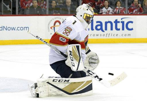 Florida Panthers goalie Roberto Luongo deflects the puck during the second period of an NHL hockey game against the New Jersey Devils, Monday, Nov. 27, 2017, in Newark, N.J. (AP Photo/Bill Kostroun)