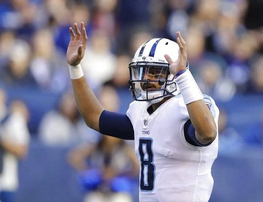 Tennessee Titans quarterback Marcus Mariota (8) reacts after a 1-yard touchdown run by running back DeMarco Murray during the second half of an NFL football game against the Indianapolis Colts, Sunday, Nov. 26, 2017, in Indianapolis. (AP Photo/Darron Cummings)