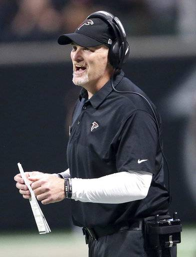 Atlanta Falcons head coach Dan Quinn watches pay against the Tampa Bay Buccaneers during the first half of an NFL football game, Sunday, Nov. 26, 2017, in Atlanta. (AP Photo/John Bazemore)