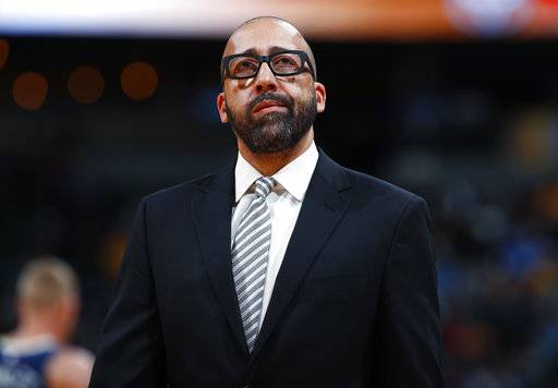 FILE - In this Nov. 24, 2017, file photo, Memphis Grizzlies head coach David Fizdale reacts as he calls a timeout while facing the Denver Nuggets in the first half of an NBA basketball game in Denver. The Grizzlies have fired Fizdale, with the team at 7-12 and a day after he benched center Marc Gasol for the fourth quarter of an eighth straight loss. General manager Chris Wallace announced the move Monday, Nov. 27, 2017. (AP Photo/David Zalubowski, File)