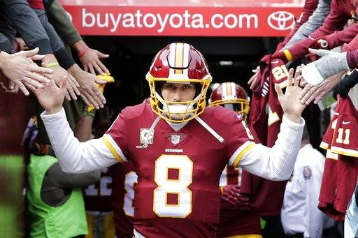 FILE - In this Nov. 12, 2017, file photo, Washington Redskins quarterback Kirk Cousins runs onto the field prior to an NFL football game against the Minnesota Vikings, in Landover, Md. Amid absurd shuffling of personnel because of injuries, Cousins has been one of the few constants on offense for the Redskins. Cousins has adapted as 27 other players have played around him this season and must continue to with an uphill climb to qualify for a playoff spot. (AP Photo/Mark Tenally, File)