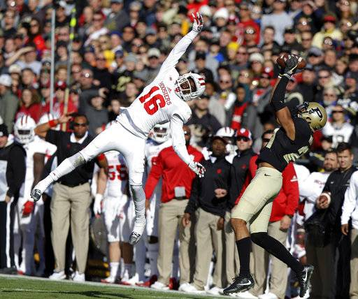 Purdue wide receiver Anthony Mahoungou (21) makes a catch behind Indiana defensive back Rashard Fant (16) on his way to a touchdown during the first half of an NCAA college football game in West Lafayette, Ind., Saturday, Nov. 25, 2017. (AP Photo/Michael Conroy)