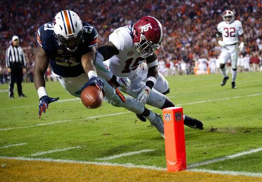 Auburn running back Kerryon Johnson (21) dives for the end zone and gets a first down as Alabama defensive back Ronnie Harrison (15) knocks him out of bounds during the Iron Bowl NCAA football game Saturday, Nov. 25, 2017, in Auburn, Ala. (Albert Cesare/The Montgomery Advertiser via AP)