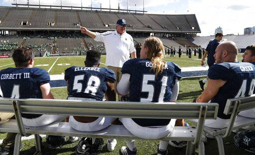 Rice head coach David Bailiff, center, talks with his team before an NCAA college football game against North Texas at Rice Stadium, Saturday, Nov. 25, 2017, in Houston. (Karen Warren/Houston Chronicle via AP)