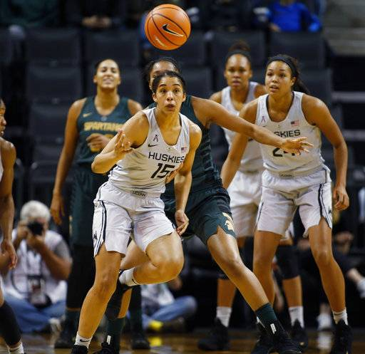 Connecticut's Gabby Williams (15) chases after a loose ball in the second half of an NCAA college basketball game against Michigan State during the Phil Knight Invitational tournament in Eugene, Ore., Saturday, Nov. 25, 2017. (AP Photo/Timothy J. Gonzalez)