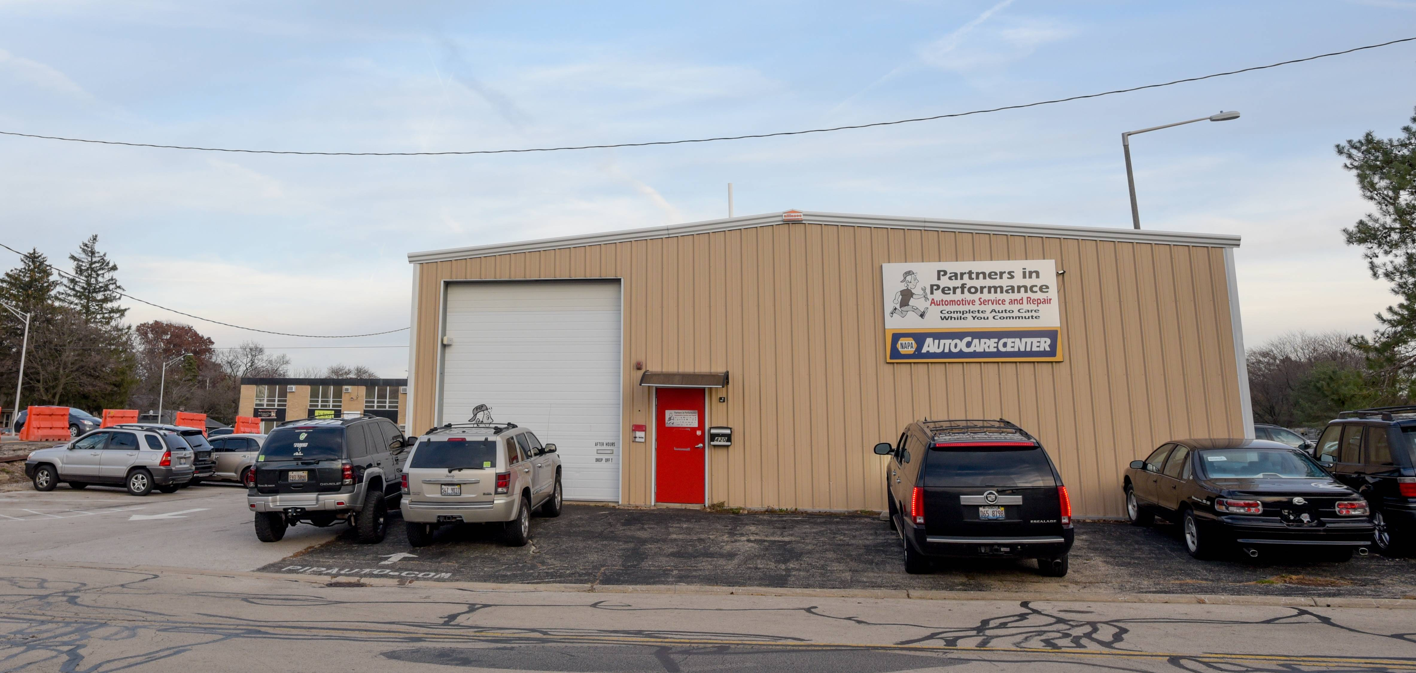 Partners in Performance Automotive Service and Repair can remain at 420 N. Center St. in the 5th Avenue redevelopment area in Naperville for another six months under a lease extension approved by the city.