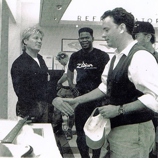 Glenview native Del Breckenfeld shakes hands with Tom Hanks on a movie set.