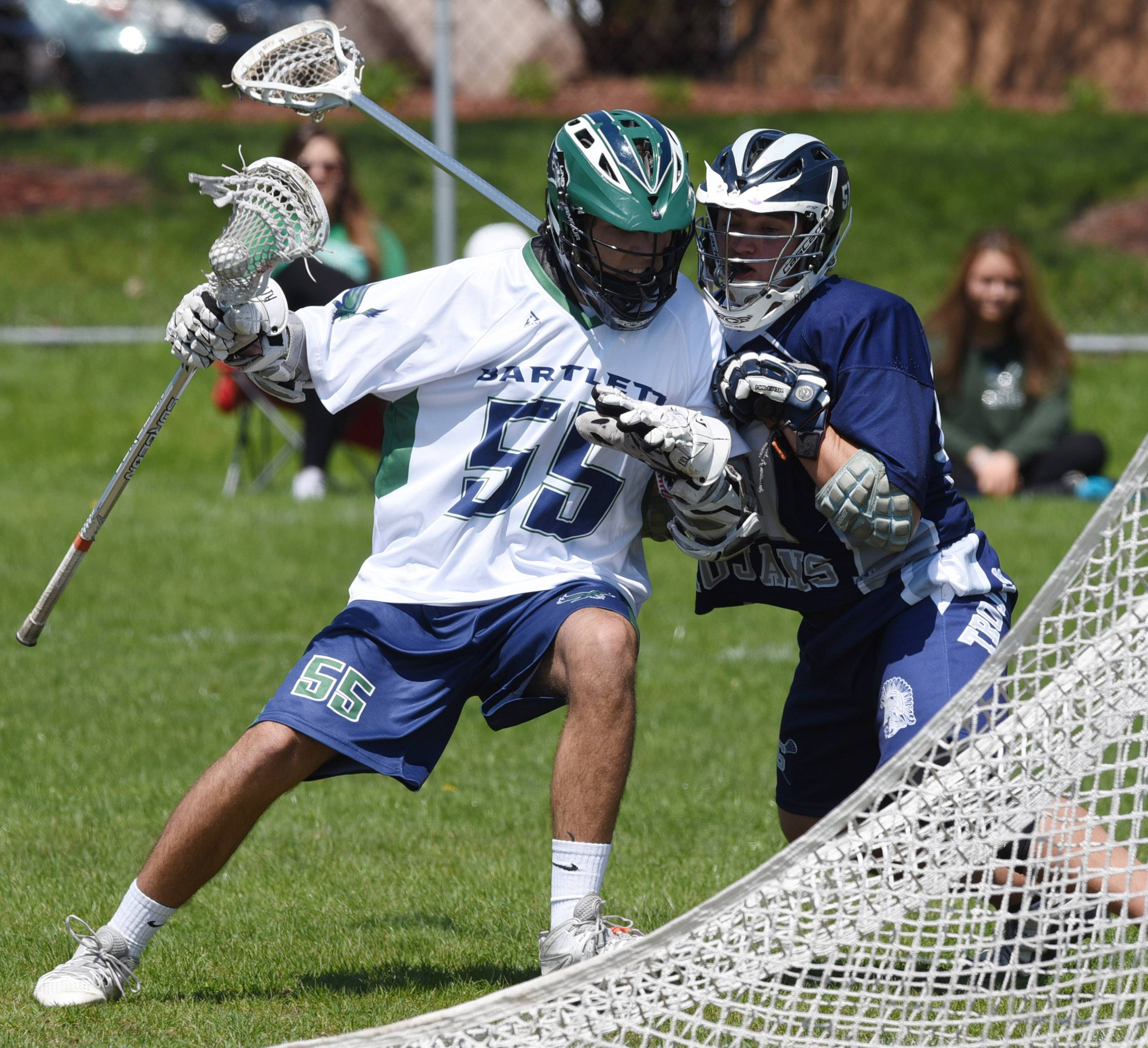 Bartlett High School's Anthony Diperte makes a move toward the net during a varsity lacrosse game against Cary-Grove in the spring of 2016. Elgin Area School District U-46 officials are considering starting district-funded cooperative lacrosse teams for high school girls and boys starting next spring.