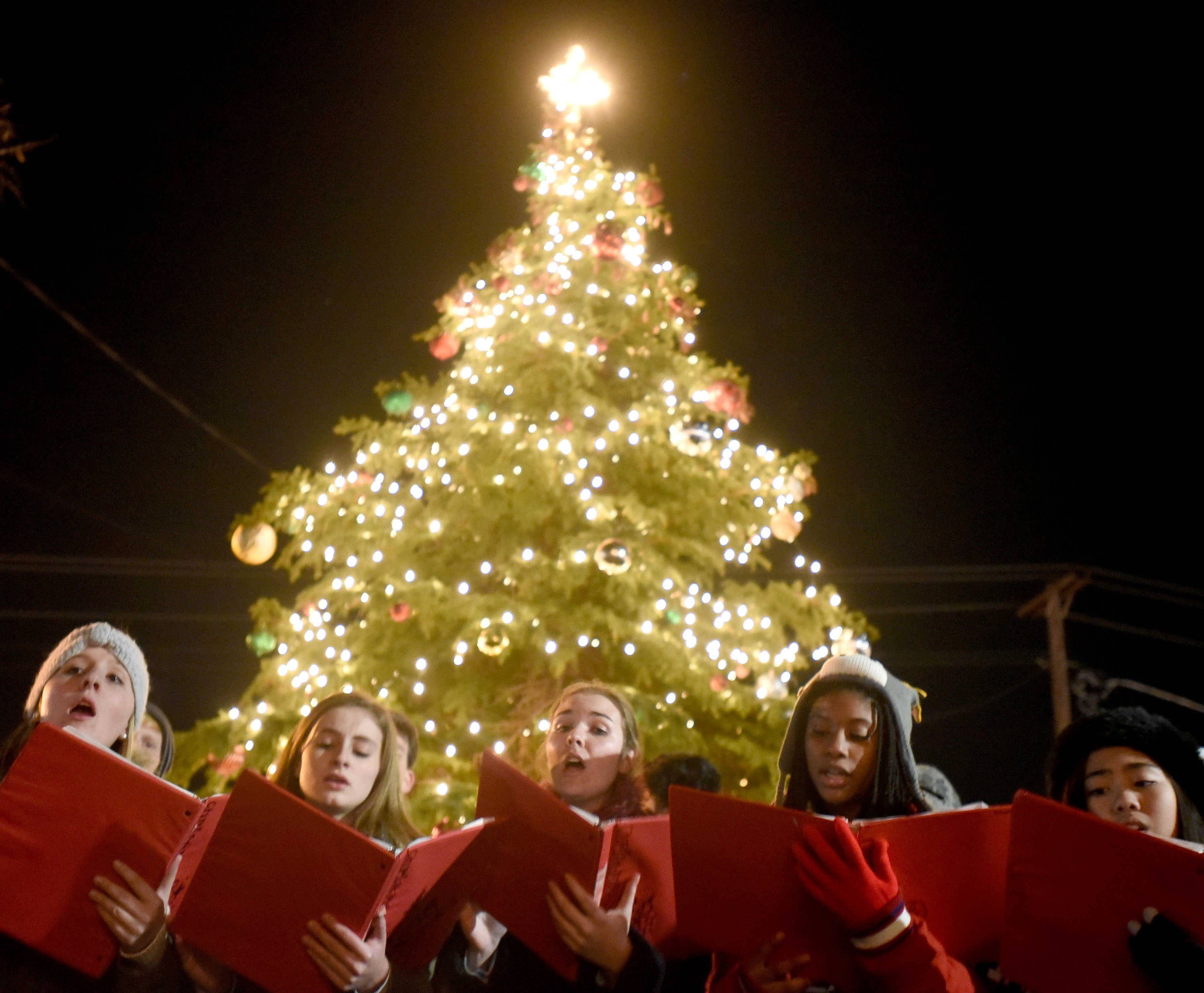 Members of the Dundee-Crown High School chamber choir perform at the East Dundee Christmas tree-lighting during the Dickens in Dundee festival.