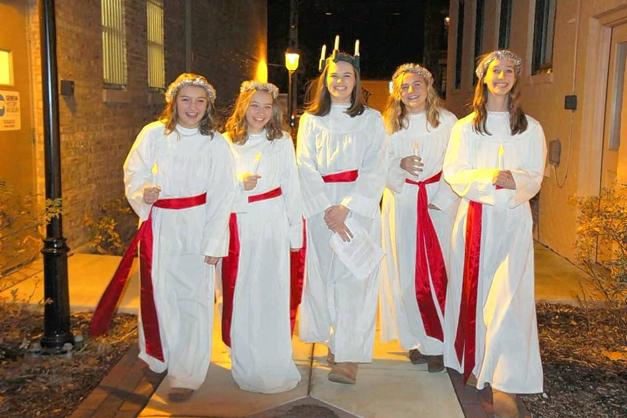 The arrival of Santa Lucia and her attendants is a favorite tradition on Friday evening at the Geneva Christmas Walk.