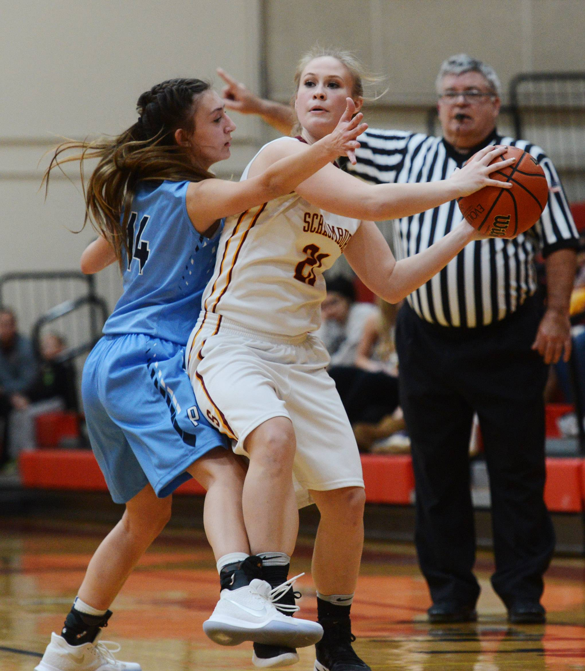 Prospect's Stephanie Kowalczyk, left, pressures Schaumburg's Meghan Luecht during Tuesday's game at Schaumburg.