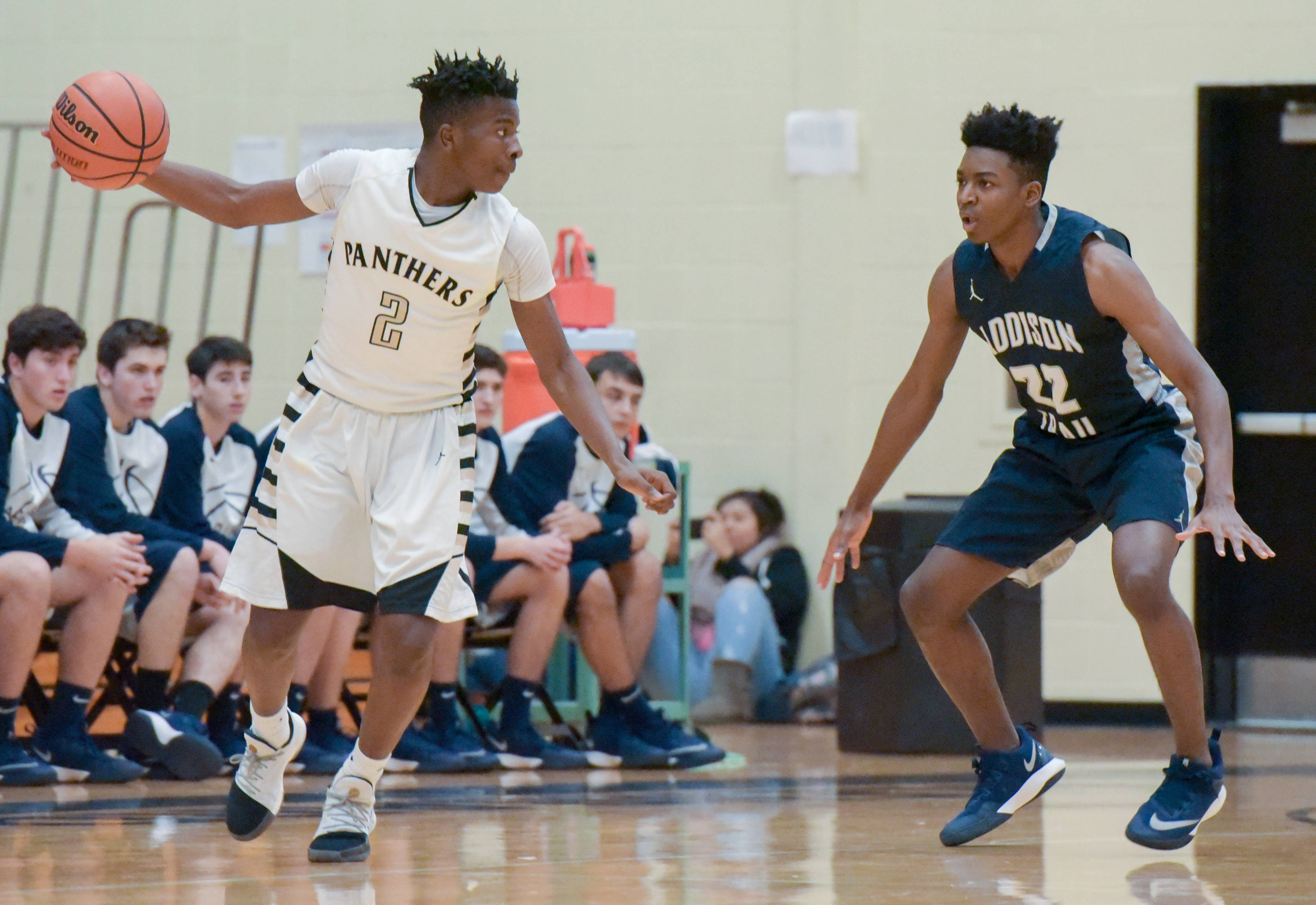 Glenbard North's Jakious Lee (2) looks to move around Addison Trail's Ramon Casey Jr. (22) during varsity boys basketball in Carol Stream on November 28, 2017.