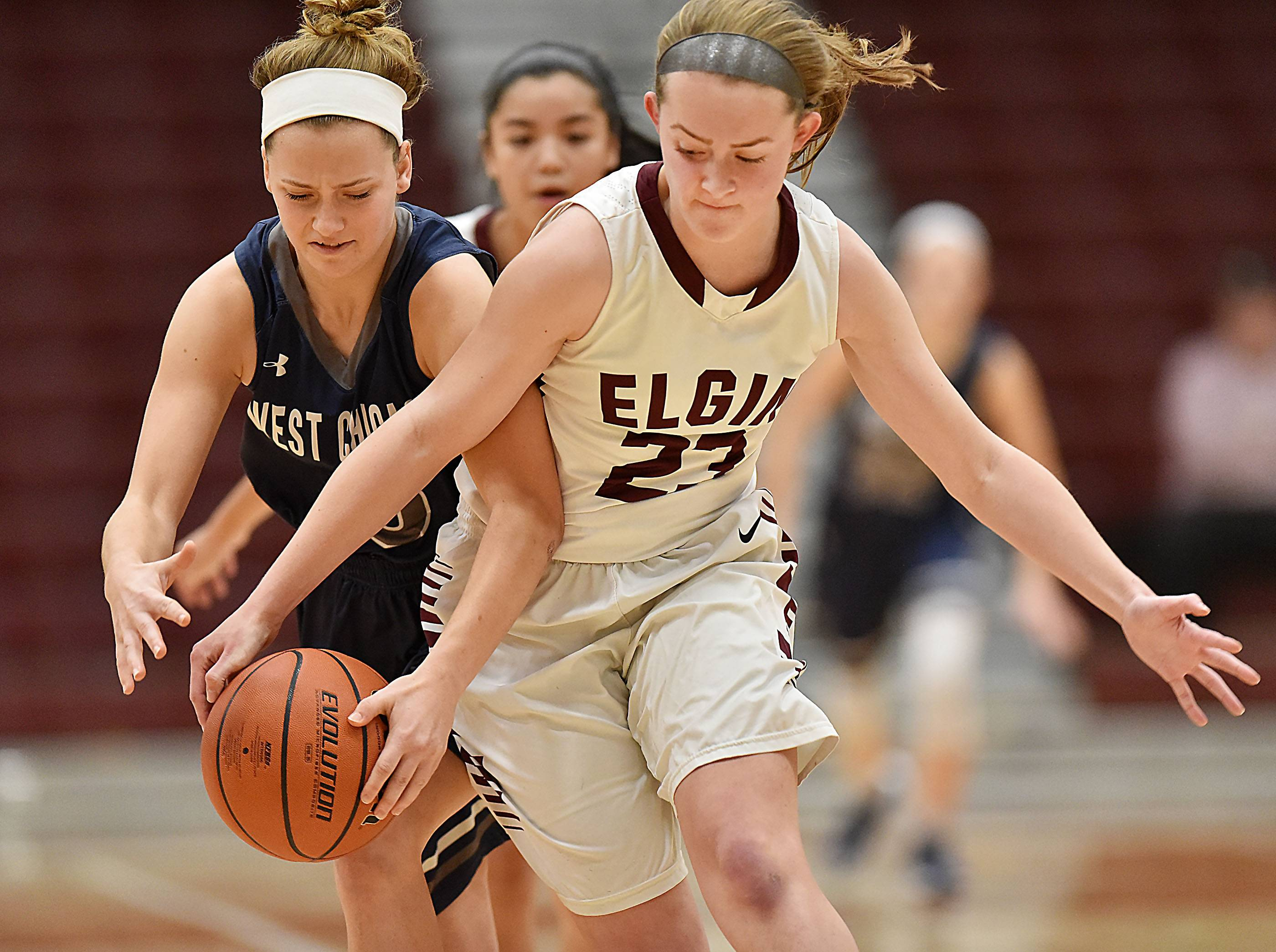 Elgin's Kylie Graves tries to take the ball from West Chicago's Sofia Radice Tuesday at Chesbrough Field House at Elgin High School.