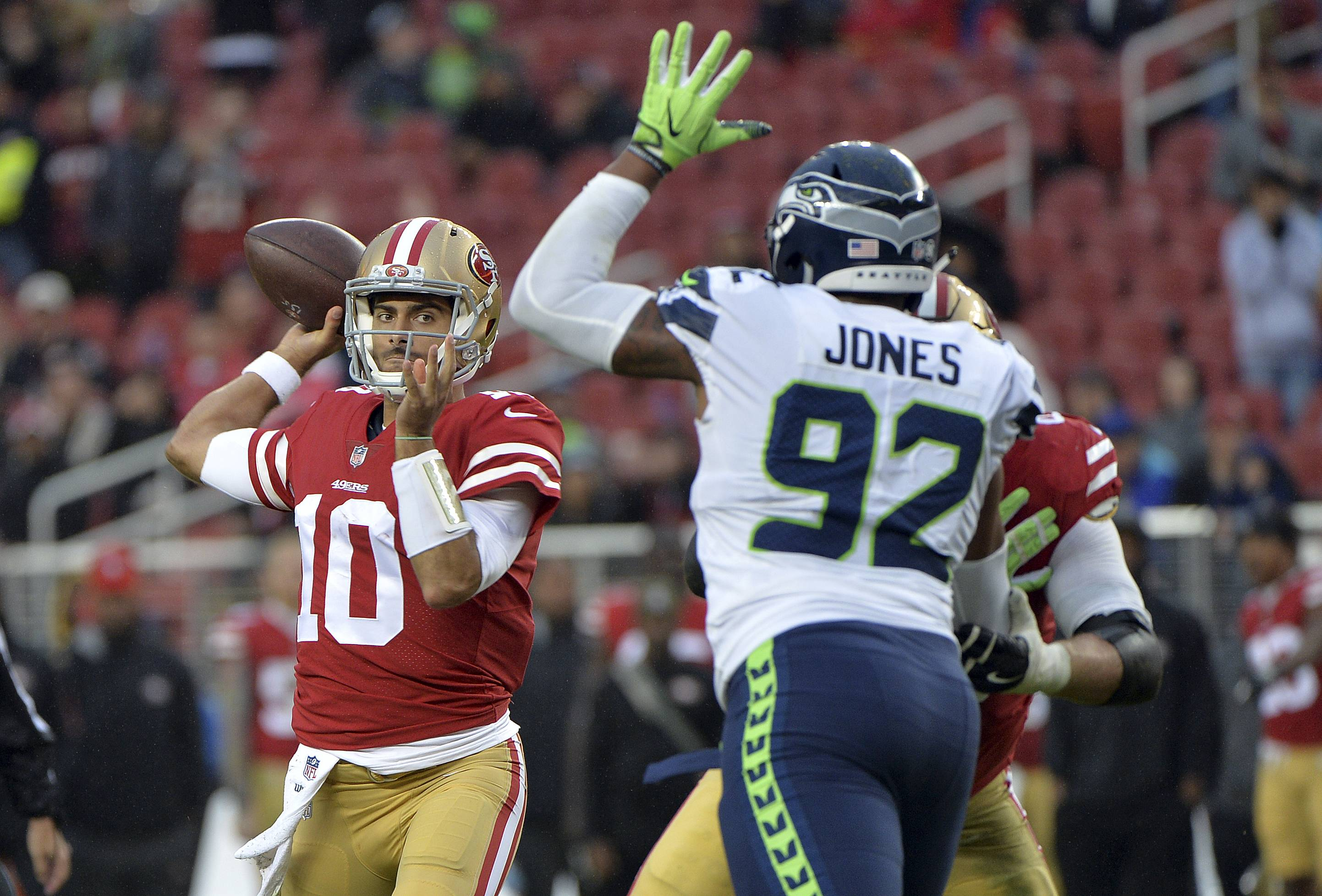 San Francisco 49ers quarterback Jimmy Garoppolo (10) throws against the Seattle Seahawks during the second half of an NFL football game Sunday, Nov. 26, 2017, in Santa Clara, Calif. (AP Photo/Don Feria)