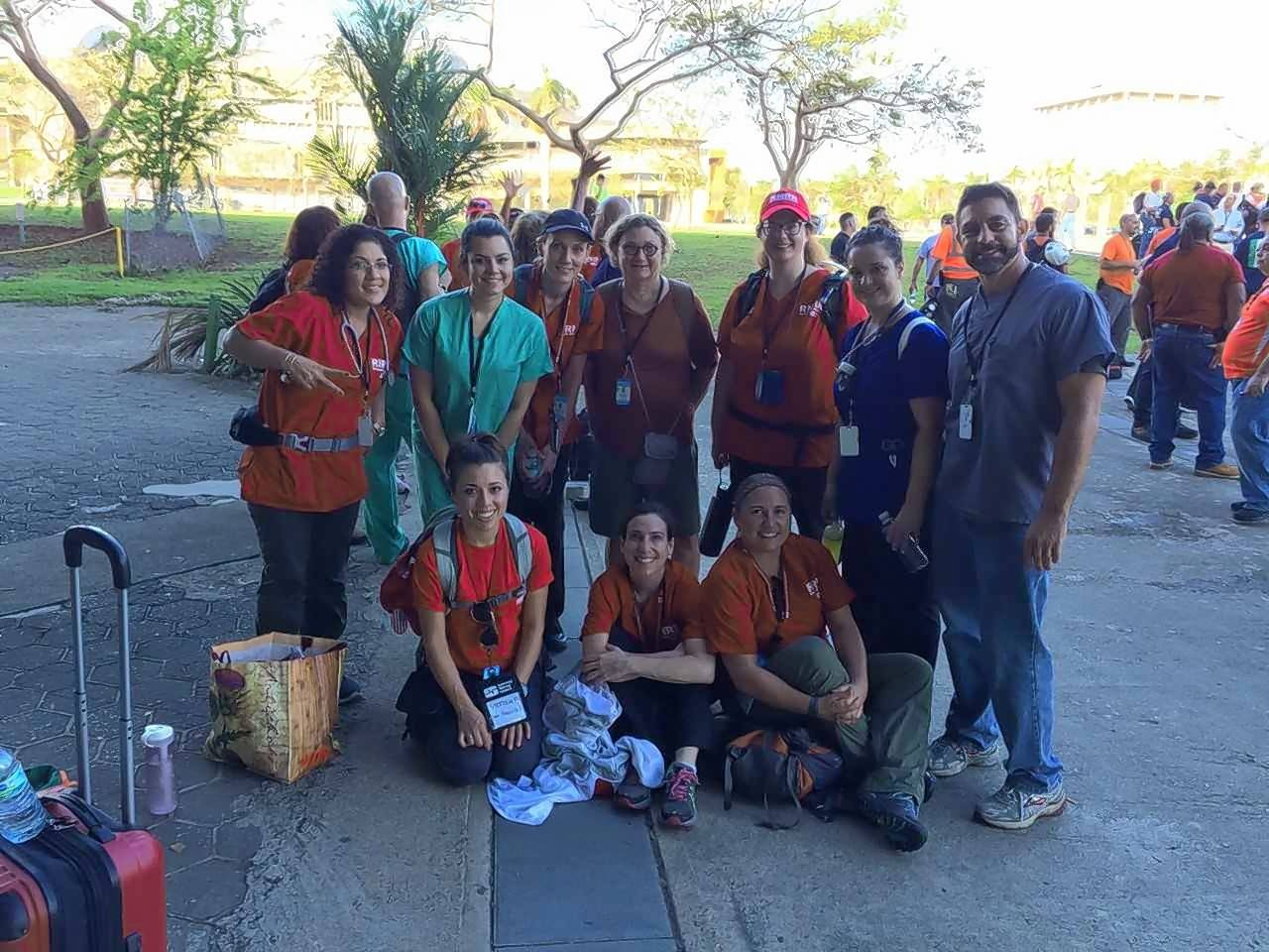 Dr. Timothy Laurie, a gastroenterologist at Advocate Lutheran General Hospital in Park Ridge, is pictured, far right, with other labor and health care volunteers in Puerto Rico. Dr. Laurie was in Puerto Rico for a week providing medical care and medical education to residents.