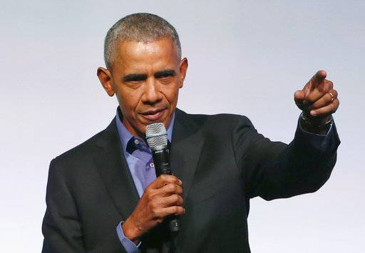 In this Nov. 1, 2017 photo, former President Barack Obama addresses the crowd as the last speaker at final session of the Obama Foundation Summit in Chicago. Obama is re-emerging on the global stage with a three-country tour that includes meetings with the leaders of China and India. Obama's office says he arrived in Shanghai on Tuesday to speak at a business summit. (AP Photo/Charles Rex Arbogast)