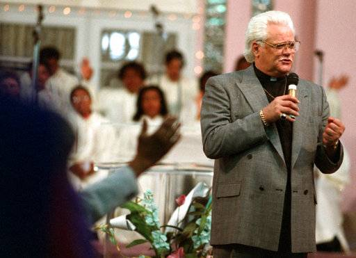 "In this May 21, 1995 photo, Wayne Cochran speaks at the Voice of Jesus Christian Center in Miami. Cochran, the ""blue-eyed soul"" singer known for his towering pompadour, has died of cancer at his Florida home, according to his son Christopher Cochran. He was 78. (Jeffery A. Salter/Miami Herald via AP)"