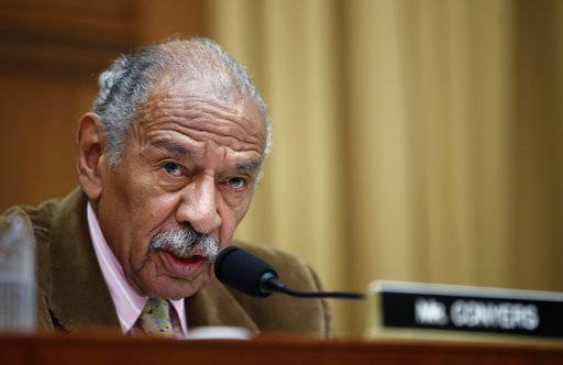 "FILE- In this April 4, 2017, file photo, Rep. John Conyers, D-Mich., speaks during a hearing of the House Judiciary subcommittee on Capitol Hill in Washington. House Democratic Leader Nancy Pelosi is defending Conyers as an ""icon"" for women's rights and declining to say whether the longtime lawmaker should resign over allegations that he sexually harassed female staff members. (AP Photo/Alex Brandon, File)"