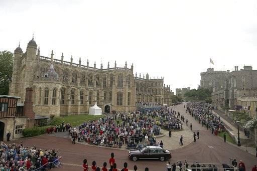 FILE - This is a Monday, June 13, 2016 file photo of St George's Chapel, left, in Windsor, England, Monday, June 13, 2016. Britain's Prince Harry and Meghan Markle will get married at the chapel in May 2018, it was announced Tuesday Nov. 28, 2017. (Steve Parsons/Pool File, via AP)